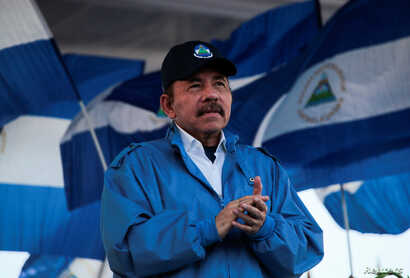 FILE - Nicaraguan President Daniel Ortega applauds during a march in Managua, Sept. 5, 2018.