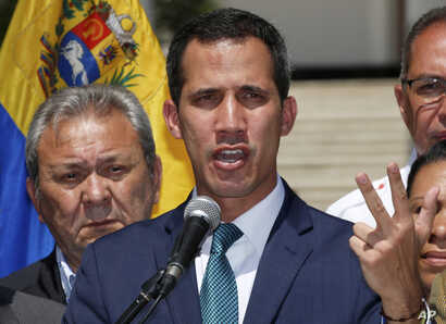 Opposition leader Juan Guaido, who has declared himself the interim president of Venezuela, speaks during a press conference on the steps of the National Assembly in Caracas, Venezuela, Feb. 4, 2019.