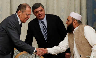 Russian Foreign Minister Sergei Lavrov welcomes member of Taliban delegation Alhaj Mohammad Sohail Shaina during the multilateral peace talks on Afghanistan in Moscow, Russia, Nov. 9, 2018.