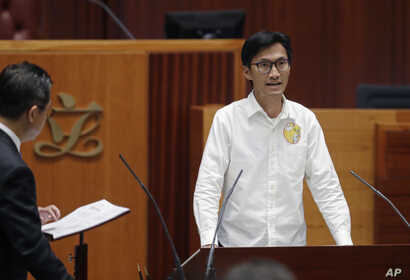 Newly elected pro-democracy lawmaker Eddie Chu takes oath in the new legislature Council in Hong Kong, Wednesday, Oct. 12, 2016.