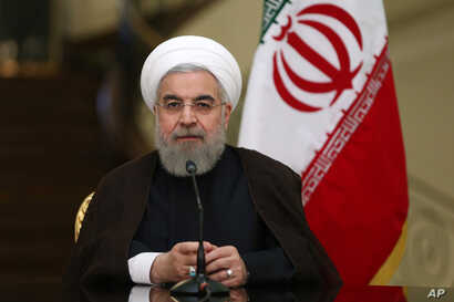 Iranian President Hassan Rouhani speaks with media in a joint press conference with his Austrian counterpart Heinz Fischer after their meeting at the Saadabad Palace in Tehran, Iran, Sept. 8, 2015.