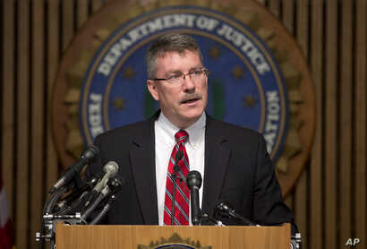 Ron Hosko, assistant director of the FBI's Criminal Investigative Division, addresses during a news conference at FBI headquarters in Washington, July 29, 2013.