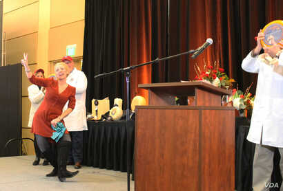 Marieke Penterman of Marieke Gouda does her happy dance that has become a familiar sight at cheese contests. At the U.S. Cheese Championship, her cheeses were ranked No. 2 and No. 3 cheeses among the 2,555, in Green Bay, Wis., March 7 2019.