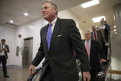 Senate Intelligence Committee Chairman Sen. Richard Burr, R-N.C., and other lawmakers return to their offices on Capitol Hill in Washington, March 2, 2017, after votes to confirm two of President Donald Trump's cabinet picks.