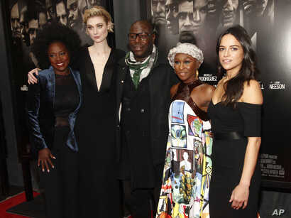 """Viola Davis, from left, Elizabeth Debicki, Steve McQueen, Cynthia Erivo and Michelle Rodriguez attend a special screening of """"Widows"""" at Brooklyn Academy of Music in New York, Nov. 11, 2018."""