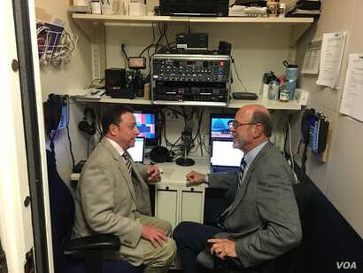 White House bureau chief Steve Herman (left) and senior correspondent Peter Heinlein discussing the day's assignments in the small VOA studio in the basement of the West Wing.