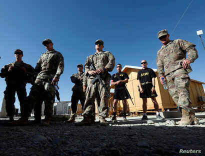 U.S. troops listen to a security briefing before leave their base in Logar province, Afghanistan, August 5, 2018.