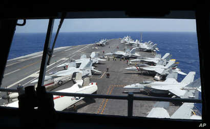 Fighter jets on board the U.S. Navy aircraft carrier USS Carl Vinson (CVN 70) are prepared for patrols off the disputed South China Sea, March 3, 2017.