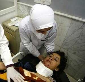 A wounded Iraqi woman receives medical care at a hospital in the northern Iraqi city of Mosul, after a double bomb attack targeting buses carrying Christian students and university workers near Mosul in killed a shopkeeper and wounded 80 other people...