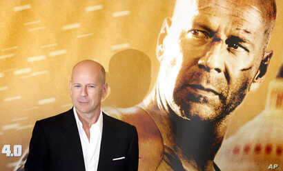 """FILE - U.S. actor Bruce Willis poses for the photographers during a photo call for his new movie """"Die Hard 4.0"""" in Berlin, Germany, June 18, 2007."""