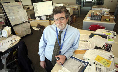 FILE - Mark Potok, of the Southern Poverty Law Center, stands in the center's office in Montgomery, Ala., June 12, 2009.