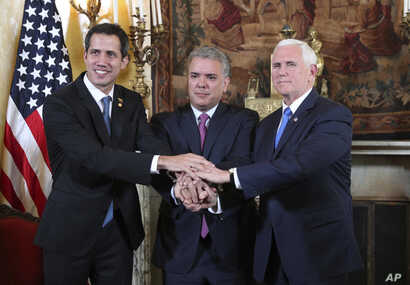 Venezuela's self-proclaimed interim president Juan Guaido, Colombia's President Ivan Duque and Vice President Mike Pence, pose for a photo after a meeting of the Lima Group concerning Venezuela at the Foreign Ministry in Bogota, Colombia, Monday, Feb...