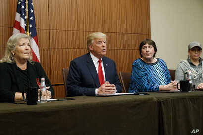 Republican presidential candidate Donald Trump, second from left, make remarks before the second presidential debate with Democratic presidential candidate Hillary Clinton, Sunday, Oct. 9, 2016, in St. Louis. From right, Paula Jones, Kathy Shelton, T...