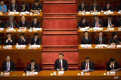 Chinese President Xi Jinping (center) listens during the opening session of the Chinese People's Political Consultative Conference in Beijing's Great Hall of the People, March 3, 2017. The head of China's legislative advisory body, Yu Zhengsheng, sa