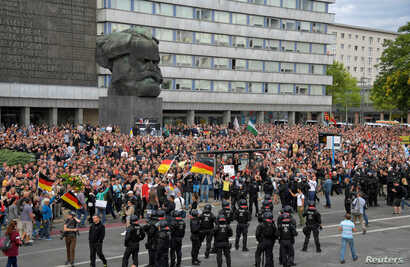 Right-wing supporters protest against foreigners after a German man was stabbed last weekend in Chemnitz, Germany, Aug. 27, 2018.