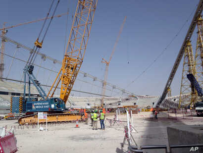 In this photo taken on Nov. 9, 2014, construction work is under way at the Khalifa Stadium in Doha, Qatar. It is one of the venues being redeveloped as Qatar prepares to host the 2022 World Cup.