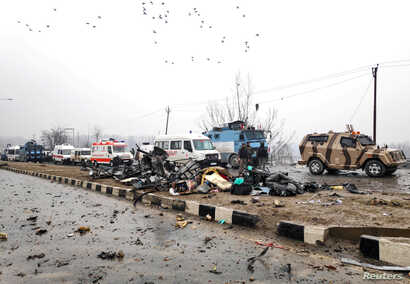 Indian soldiers examine the debris after an explosion in Lethpora in south Kashmir's Pulwama district, Feb. 14, 2019.