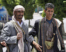 Armed tribesmen, loyal to Sheik Sadeq al-Ahmar, the head of the powerful Hashid tribe, stand guard in a street around al-Ahmar's house, during clashes with Yemeni security forces in Sana'a, June 6, 2011.