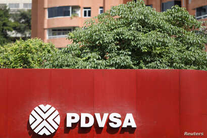 The corporate logo of the state oil company PDVSA is seen at a gas station in Caracas, Venezuela Nov. 16, 2017.