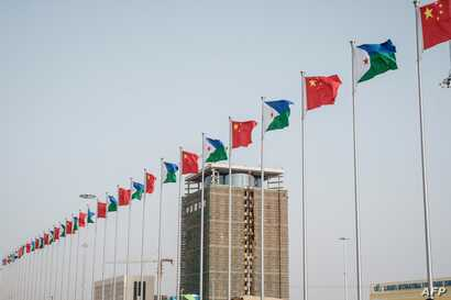 National flags of China and Djibouti are seen in front of Djibouti International Free Trade Zone (DIFTZ) before the inauguration ceremony in Djibouti, July 5, 2018.