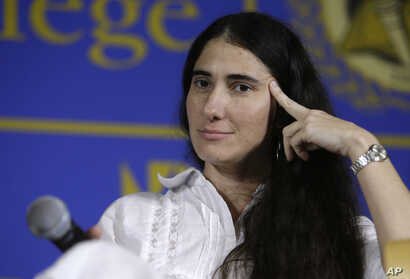 FILE - In this April 1, 2013 file photo, Cuba's best-known blogger Yoani Sanchez speaks at the Freedom Tower of Miami Dade College, in Miami, Florida. Sanchez said she will start publishing a general-interest newspaper online Wednesday, May 21, 201...