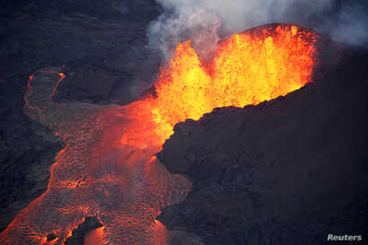 Lava erupts in Leilani Estates during ongoing eruptions of the Kilauea Volcano in Hawaii, June 5, 2018.