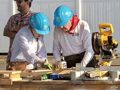 """Former President Jimmy Carter and first lady Rosalyn Carter worked. """"Nobody works harder than them, and they set an example for everybody, they really do,"""" Trisha Yearwood said, standing nearby as the Carters cut wood and assembled material that ..."""