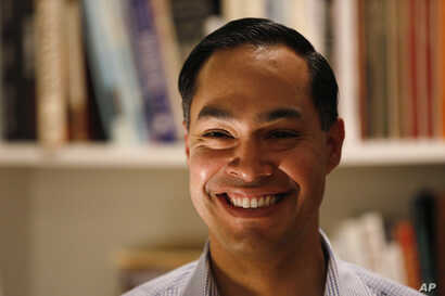 Former Housing and Urban Development Secretary Julian Castro speaks during a house party at the Ed and Jane Cranston home, Jan. 7, 2019, in North Liberty, Iowa.