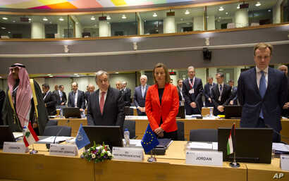 European Union High Representative Federica Mogherini, center right, and United Nations Secretary General Antonio Guterres, center left, stand for a moment of silence for the Syrian victims of war at an EU Syria conference at the Europa building in B...