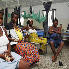 Pregnant women watch television as they wait in the prenatal ward at Princess Christian Maternity Hospital in Freetown, Sierra Leone (File Photo)