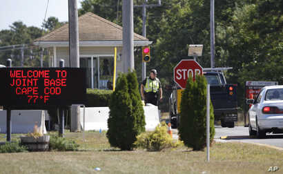 Vehicles are stopped by security personal as they enter a gate to Camp Edwards, Massachusetts, on Cape Cod, Sept. 22, 2014. Police and military officials were searching Monday for three soldiers from the Afghanistan National Army who went missing Sat...