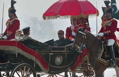 Pakistan President Mamnoon Hussain arrives to attend a military parade to mark Pakistan's Republic Day in Islamabad, Pakistan, Thursday, March 23, 2017. Hussain says Pakistan is ready to hold talks with India on all issues, including Kashmir, as he o...