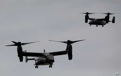 U.S. Marine Corps V-22 Osprey aircrafts approach for landing carrying the President Barack Obama press corps at JFK International airport in New York, Sept. 25, 2014.