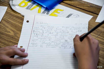 A student, Blake Mechels, writes a letter to student Elisa, of Dadaab Refugee Camp. Fifth graders at Valley Peaks Elementary School participate in a Letters of Hope project in Boulder, Colorado to respond to letters written from Somali and South Suda...