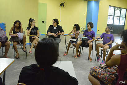 """Young girls participate in a """"One Win Leads to Another"""" workshop about leadership and self-esteem, sexual and reproductive health and rights, ending violence against women and girls and financial planning, at Olympic Vila of Mangueira, north of Rio ..."""