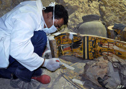 Egyptian archaeologists have discovered six mummies, colourful wooden coffins and more than 1,000 funerary statues in the 3,500-year-old tomb, the antiquities ministry said.