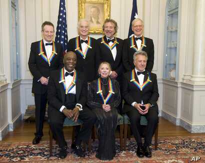 The 2012 Kennedy Center Honorees, from left, John Paul Jones, Buddy Guy, Jimmy Page, Natalia Makarova, Robert Plant, Dustin Hoffman, and David Letterman pose for a group photo Dec. 1, 2012 at the State Department in Washington.