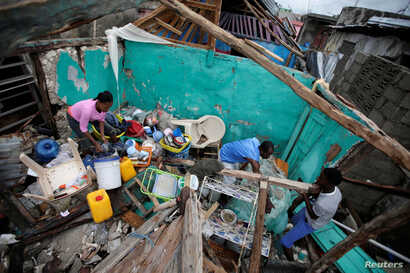 Residents work clearing a house destroyed by Hurricane Matthew in Les Cayes, Haiti, October 5, 2016.
