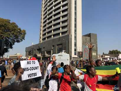 Protesters argue that election results are false and that opposition leader Nelson Chamisa is the true winner, in Harare, Aug. 1, 2018.
