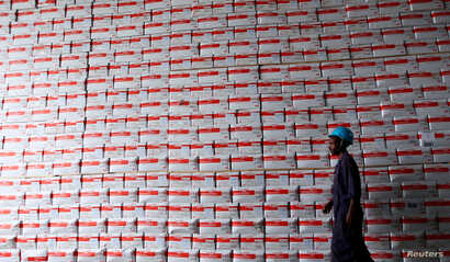 A worker walks past boxes of therapeutic food to be distributed to the malnourished population inside the United Nations International Children's Emergency Fund (UNICEF) warehouse in Ethiopia's capital Addis Ababa, April 22, 2016.