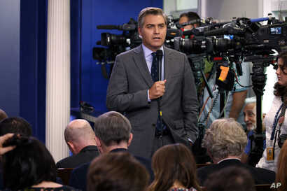 FILE - CNN journalist Jim Acosta does a stand-up before the daily press briefing at the White House, in Washington, Aug. 2, 2018.