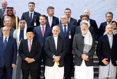 Afghan President Ashraf Ghani  poses for a group photo during a peace and security cooperation conference in Kabul, Afghanistan, Feb. 28, 2018.
