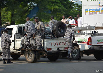 Burundi policemen patrol the street following a grenade attack in Bujumbura, Burundi. At least a dozen people were wounded on Feb. 15 when attackers on a motorbike hurled three grenades and various locations in the capital, the latest in a string of ...