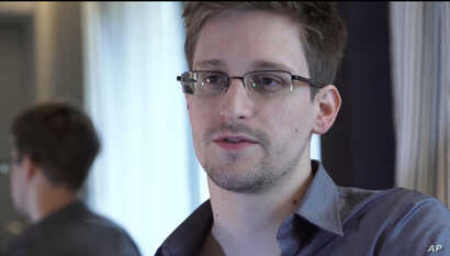This photo provided by The Guardian Newspaper in London shows Edward Snowden, who worked as a contract employee at the National Security Agency, June 9, 2013, in Hong Kong.