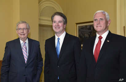 Senate Majority Leader Mitch McConnell of Kentucky, from left, poses for a photo with Supreme Court nominee Brett Kavanaugh and Vice President Mike Pence as they visit Capitol Hill in Washington, July 10, 2018.
