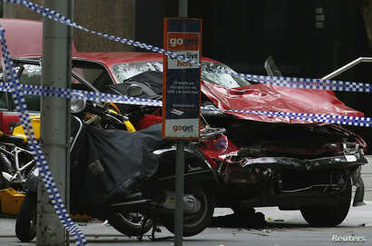 The wreckage of a car is seen as police cordoned off Bourke Street mall, after a car hit pedestrians in central Melbourne, Australia, Jan. 20, 2017.