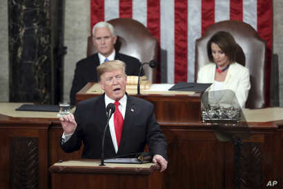 President Donald Trump delivers his State of the Union address to a joint session of Congress on Capitol Hill in Washington, as Vice President Mike Pence and Speaker of the House Nancy Pelosi, D-Calif., watch, Feb. 5, 2019.
