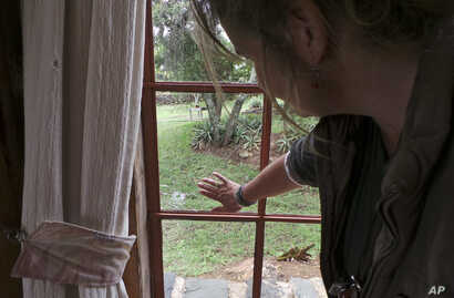 Livestock breeder Maria Dodds shows a bullet hole in a window after her home was attacked by armed herders in Laikipia, Kenya, July 26, 2017.