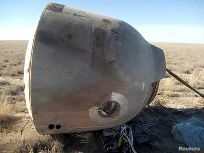 A view shows the Soyuz capsule that carried U.S. astronaut Nick Hague and Russian cosmonaut Alexei Ovchinin, after it made an emergency landing, near the city of Zhezkazgan in central Kazakhstan, Oct. 11, 2018.