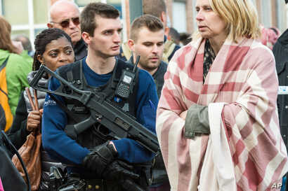 A police officer stands guard as people are evacuated from Brussels airport, after explosions rocked the facility in Brussels, Belgium, March 22, 2016.